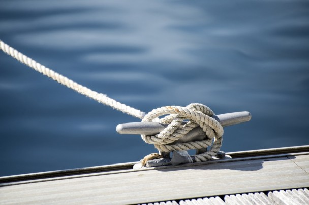 sailing roped to pier